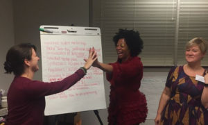 Leaders high five with new solutions